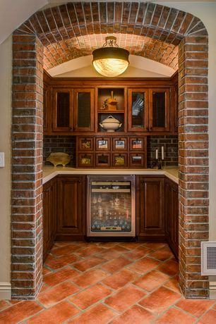 Eclectic Pantry with Standard height, Built-in bookshelf, terracotta tile floors, interior brick, flush light