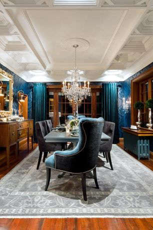 Traditional Dining Room with interior wallpaper, Hardwood floors, Standard height, French doors, Crown molding, Casement