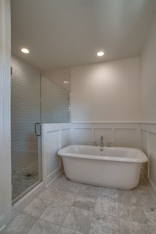 Traditional Master Bathroom with Signature Hardware Dorset Bateau Cast Iron Tub, Freestanding, frameless showerdoor