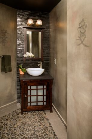 Asian Powder Room with Vessel sink, Powder room, Soapstone counters, Multi pebble marble mosaic, Inset cabinets, Glass panel