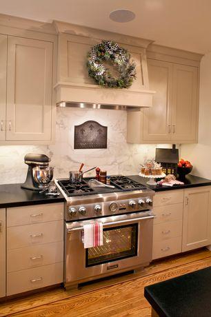 Traditional Kitchen with One-wall, full backsplash, Custom hood, gas range, Kitchen island, Flat panel cabinets, Stone Tile