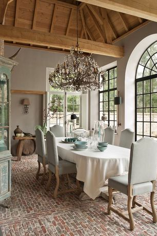 Eclectic Dining Room with High ceiling, Brick floors, French doors, Chandelier, Casement, Exposed beam, Transom window