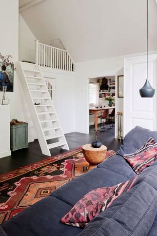 Eclectic Living Room with Magical thinking diamond kilim pillow, specialty door, Exposed beam, Pendant light, Vitra Cork A
