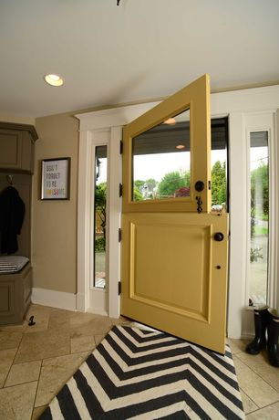 Traditional Entryway with Dutch door, Built-in bookshelf, nuLOOM - Marrakesh Meridian Chevron Black Area Rug, Concrete tile