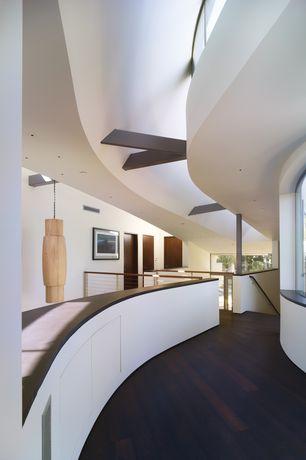 Contemporary Hallway with Hardwood floors, Exposed beam