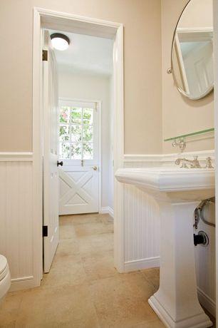 Cottage Powder Room with Beadboard, Pedestal sink, specialty door, Glass panel door, Wainscoting, Wall-mounted mirror