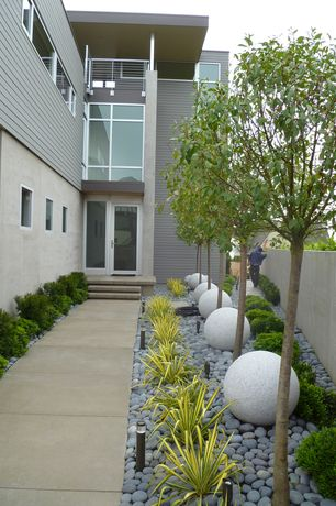 Contemporary Landscape/Yard with Fence, French doors, Mexican Beach Pebbles, Stone Granite Balls, exterior tile floors