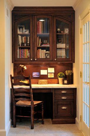 Craftsman Home Office with Built-in bookshelf, French doors, Crown molding, can lights, Standard height, sandstone floors