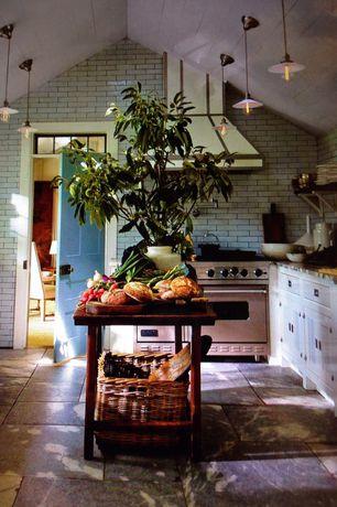 Kitchen with slate tile floors, Pendant light, stone tile floors, Inset cabinets, double oven range, High ceiling, U-shaped