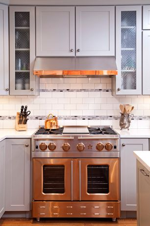 Traditional Kitchen with Glass panel, Corian counters, Flat panel cabinets, Subway Tile, Flush, L-shaped, White subway tile