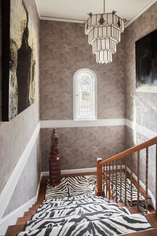 Eclectic Staircase with Arched window, curved staircase, Hardwood floors, Chandelier, Crown molding, Chair rail, High ceiling