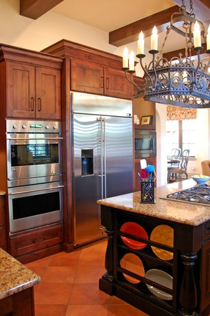 Mediterranean Kitchen with Built In Refrigerator, built-in microwave, double wall oven, Kitchen island, Chandelier, Casement