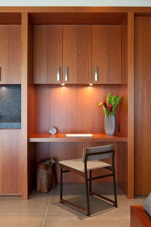 Contemporary Home Office with Concrete tile , Built-in bookshelf