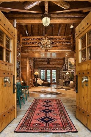 Rustic Entryway with Exposed beam, sandstone floors, Rustic pine entry door, Glass panel door, Chandelier, High ceiling