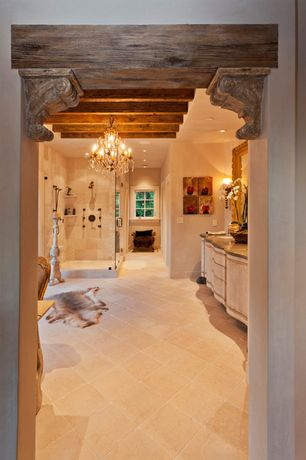 Eclectic Master Bathroom with Handheld showerhead, frameless showerdoor, Ann sacks crema marfil square field, Wall sconce