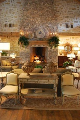 Rustic Living Room with High ceiling, Wall sconce, stone fireplace, Hardwood floors