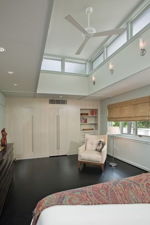 Modern Master Bedroom with Built-in bookshelf, Hardwood floors, Wall sconce, Ceiling fan, High ceiling