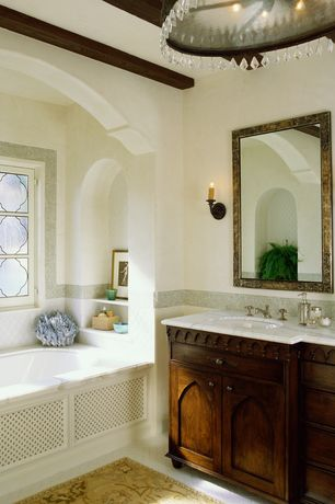 Mediterranean Master Bathroom with Stained glass window, drop in bathtub, Exposed beam, Undermount sink, Master bathroom