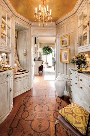 Traditional Hallway with Crown molding, High ceiling, Built-in bookshelf, Hardwood floors, Chandelier