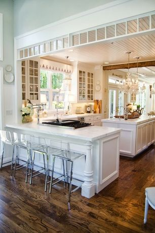 Traditional Kitchen with Complex marble counters, electric cooktop, Standard height, Kitchen island, Crown molding, Flush