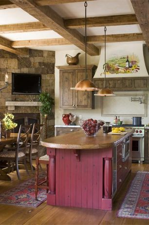 Country Kitchen with Flat panel cabinets, Breakfast nook, Limestone Tile, Chandelier, Stone Tile, Wood counters, One-wall
