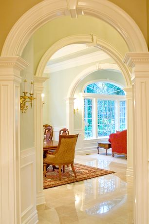Traditional Hallway with Chair rail, Crema marfil 12 in. x 12 in. marble floor and wall tile, Wall sconce, Arched window