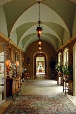Traditional Hallway with Persian rug, limestone floors, Paint 1, Paint 3, Crown molding, Pendant light, French doors, Paint 2