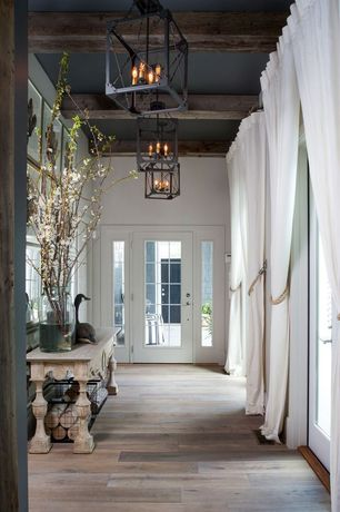 Rustic Entryway with French doors, Chandelier, Standard height, Exposed beam, Paint 1, Hardwood floors