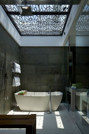 Contemporary Master Bathroom with Handheld showerhead, Vessel sink, Skylight, Master bathroom, Concrete tile , Rain shower