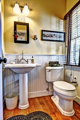 Country Powder Room with Hardwood floors, Kohler devonshire vitreous china pedestal bathroom sink combo in white, Powder room