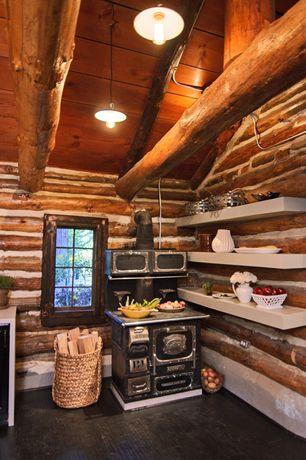 Rustic Kitchen with Casement, Hardwood floors, Antique stove, Pendant light, Slate counters, Floating shelves, Kitchen island