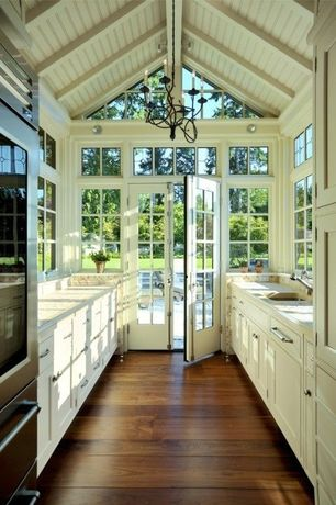 Cottage Kitchen with High ceiling, Complex Granite, French doors, U-shaped, Complex granite counters, Exposed beam