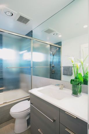 Contemporary Full Bathroom with Corian counters, Undermount sink, Kohler Ladena Undermount Bathroom Sink, European Cabinets