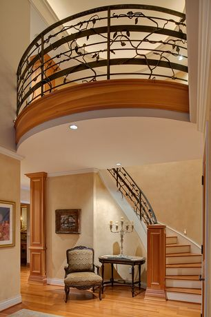 Craftsman Staircase with can lights, Crown molding, Loft, High ceiling, curved staircase, Laminate floors
