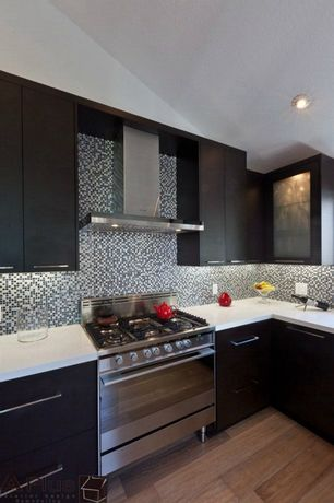 Contemporary Kitchen with Wall Hood, L-shaped, Standard height, Glass panel, gas range, can lights, Hardwood floors, Flush