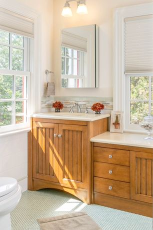 Traditional Full Bathroom with Corian counters, Undermount sink, Flat panel cabinets, Corian Solid Surface in Glacier Ice