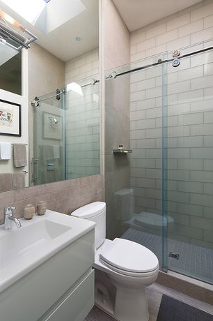 Contemporary 3/4 Bathroom with Corian counters, Undermount bathroom sink, wall-mounted above mirror bathroom light, Skylight