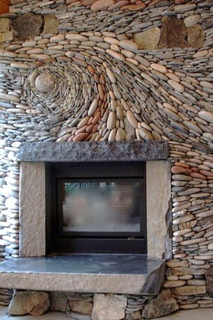Eclectic Living Room with River rock fireplace, River rock wave wall