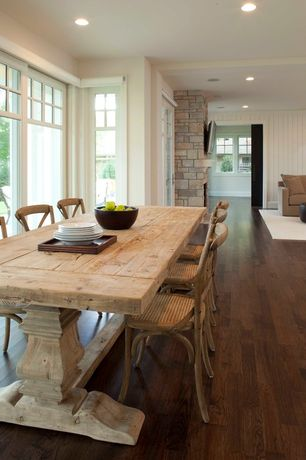 Country Dining Room with stone fireplace, Hardwood floors, French doors, Standard height, Paint 1, specialty window