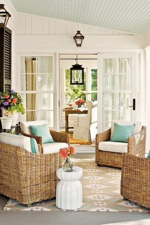 Cottage Porch with French doors, Geometric area rug, Lantern chandelier, double-hung window, Fluted lotus garden stool