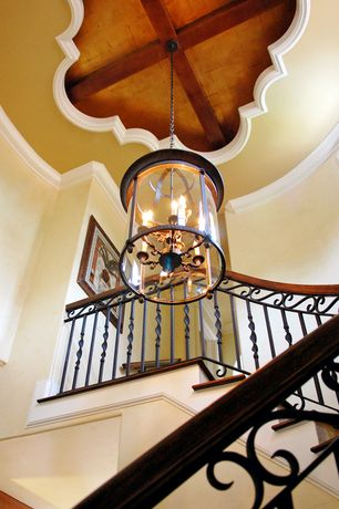 Mediterranean Staircase with Hardwood floors, Exposed beam, Cathedral ceiling, Crown molding, Chandelier