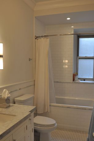 Traditional Full Bathroom with Wall sconce, Inset cabinets, Simple marble counters, tiled wall showerbath, Crown molding
