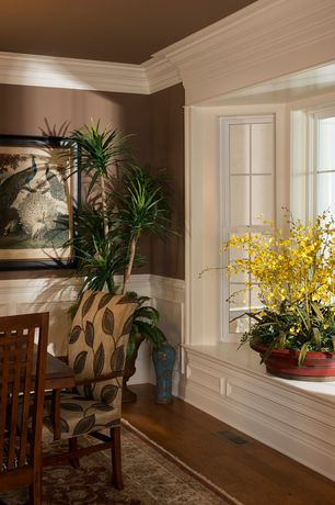 "Traditional Dining Room with Window seat, Mohawk Lineage 3"" Engineered Brazilian Cherry Flooring in Natural, Crown molding"