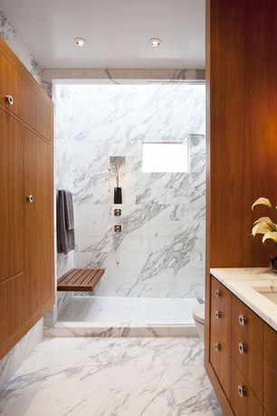 Contemporary Full Bathroom with three quarter bath, can lights, Flush, Vase slim black, stone tile floors, European Cabinets