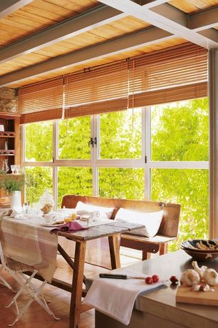 Rustic Dining Room with Built-in bookshelf, Exposed beam, picture window, Casement, Standard height, Laminate floors