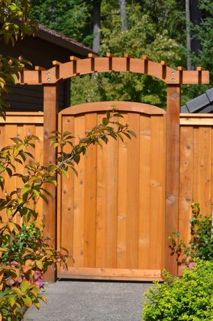 Craftsman Landscape/Yard with Custom cedar fence, Wood entrance gate, Exterior concrete pathway