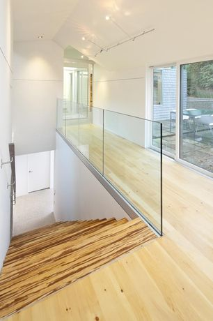 Modern Staircase with Hull Forest Products Maple Wide Plank Floors, InvisiRail Glass Rail System
