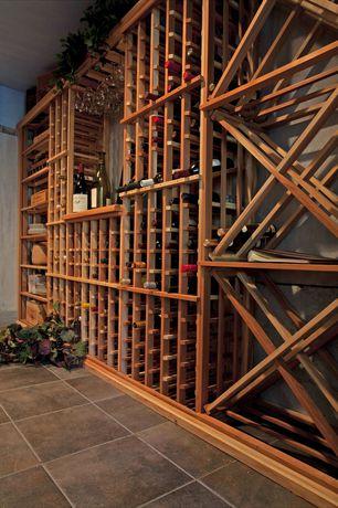 Craftsman Wine Cellar with Concrete tile , Built-in bookshelf, Standard height
