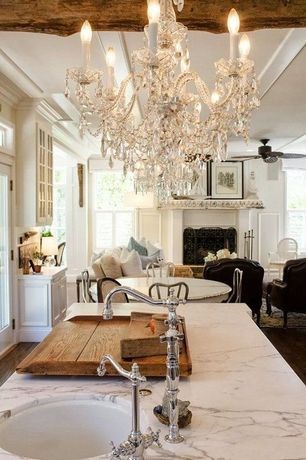 Traditional Great Room with Chandelier, Fireplace, Glass panel door, metal fireplace, Exposed beam, Hardwood floors
