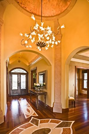 Mediterranean Entryway with Arched window, Chandelier, Paint, High ceiling, Traditional double front doors, Glass panel door